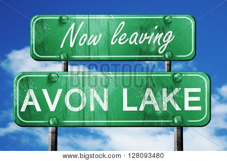 Leaving avon lake, green vintage road sign with rough lettering