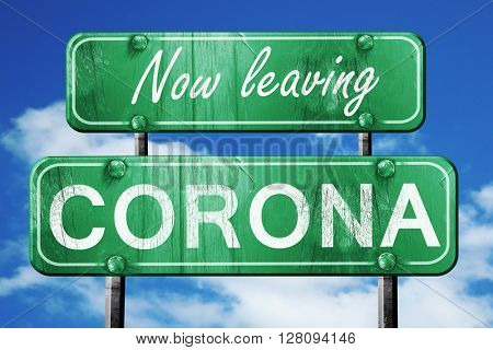 Leaving corona, green vintage road sign with rough lettering