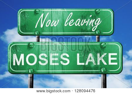 Leaving moses lake, green vintage road sign with rough lettering