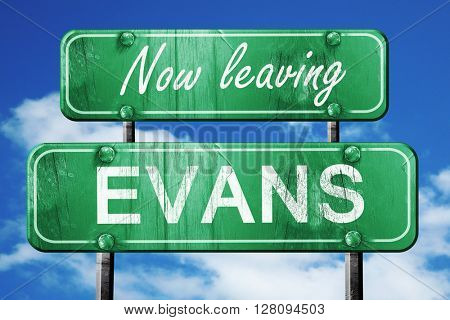 Leaving evans, green vintage road sign with rough lettering