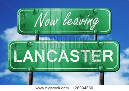 Leaving lancaster, green vintage road sign with rough lettering