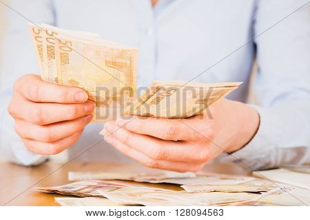 Businesswoman Counting Euros