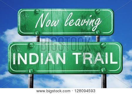 Leaving indian trail, green vintage road sign with rough letteri