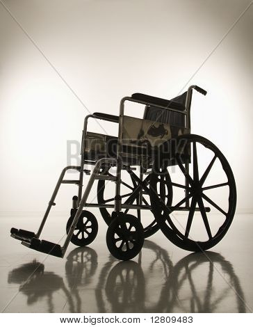 Empty silhouetted wheelchair.