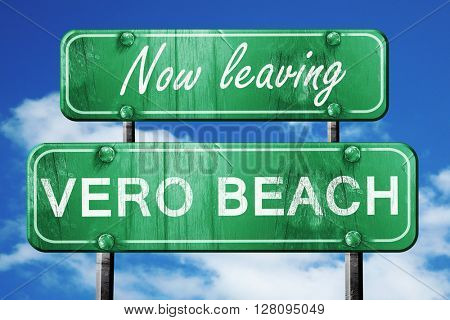 Leaving vero beach, green vintage road sign with rough lettering