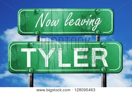 Leaving tyler, green vintage road sign with rough lettering