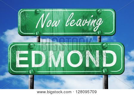 Leaving edmond, green vintage road sign with rough lettering
