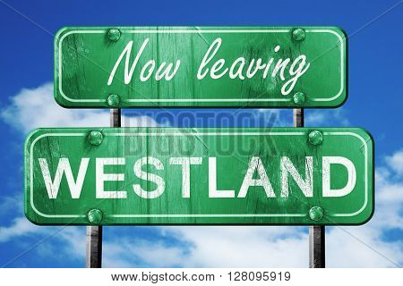 Leaving westland, green vintage road sign with rough lettering