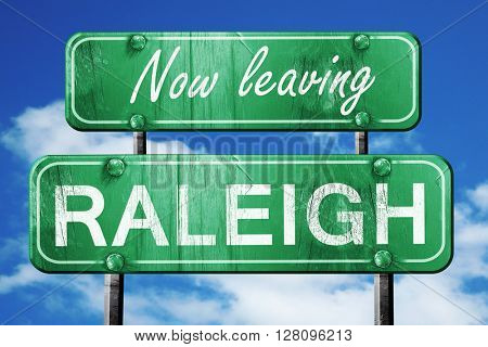 Leaving raleigh, green vintage road sign with rough lettering