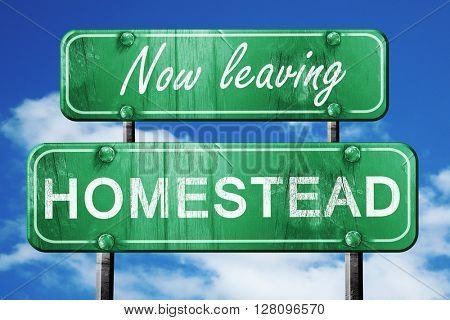 Leaving homestead, green vintage road sign with rough lettering