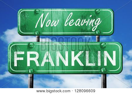 Leaving franklin, green vintage road sign with rough lettering