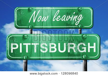 Leaving pittsburgh, green vintage road sign with rough lettering