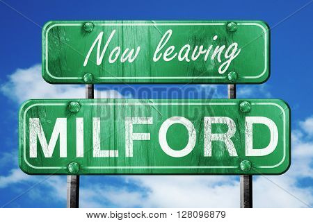 Leaving milford, green vintage road sign with rough lettering