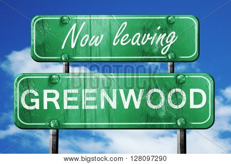 Leaving greenwood, green vintage road sign with rough lettering