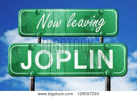 Leaving joplin, green vintage road sign with rough lettering