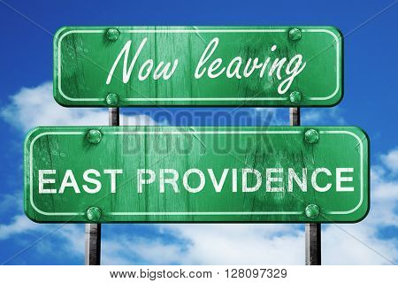 Leaving east providence, green vintage road sign with rough lett