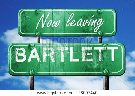 Leaving bartlett, green vintage road sign with rough lettering