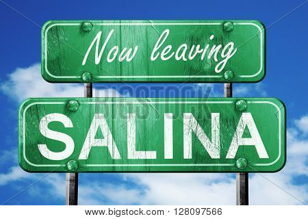 Leaving salina, green vintage road sign with rough lettering
