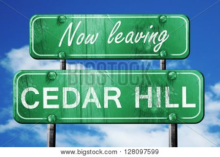 Leaving cedar hill, green vintage road sign with rough lettering