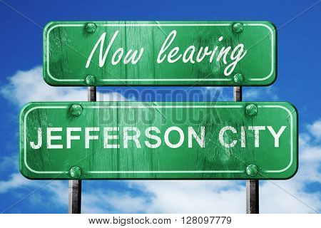 Leaving jefferson city, green vintage road sign with rough lette