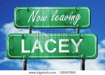 Leaving lacey, green vintage road sign with rough lettering