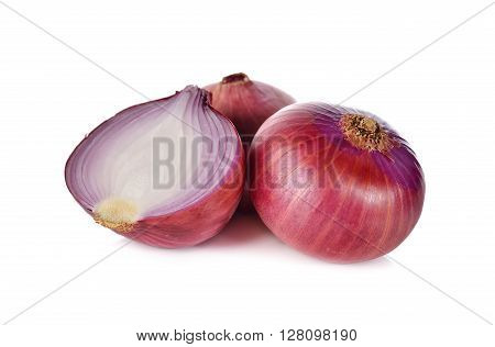whole and half cut red onion shallots on white background