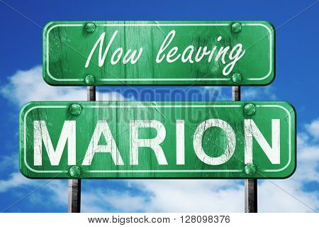 Leaving marion, green vintage road sign with rough lettering