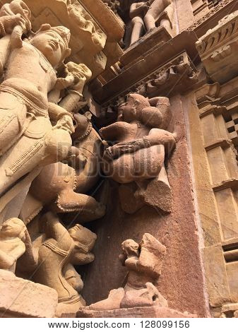 India, Khajuraho, Erotic relief on a hindu temple, Kamasutra relief