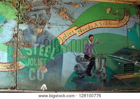 JOLIET, ILLINOIS / UNITED STATES - APRIL 12, 2015: A painting on the wall of the Jefferson Street Viaduct advertises the need for Joliet to have a stadium.