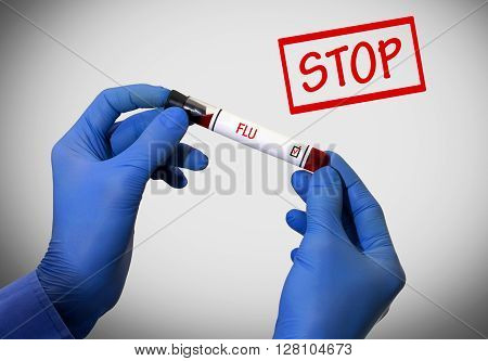 Stop flu. Positive result of blood test. Test tube with a blood test in the doctor's hands. Medical concept.