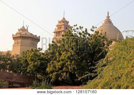 Stone domes of Umaid Bhavan Palace behind greenery Jodhpur Rajasthan India Asia