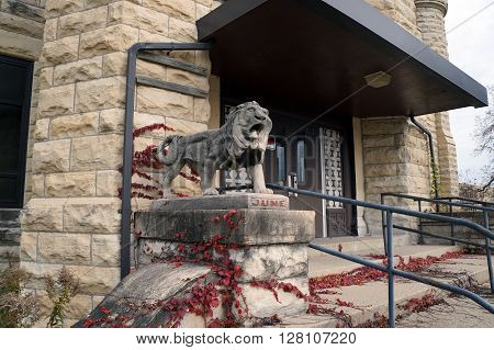 JOLIET, ILLINOIS / UNITED STATES - JANUARY 1, 2013:  A sculpture of a lion stands in front of the former women's building of the old Illinois State Penitentiary in Joliet, Illinois