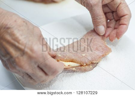 Cordon bleu preparation : Filling the pork loin with cheese and ham