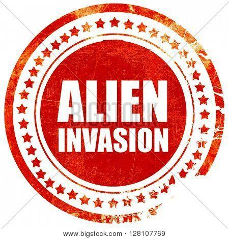 alien invasion, red grunge stamp on solid background
