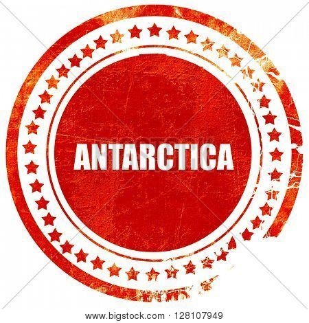 antarctica, red grunge stamp on solid background
