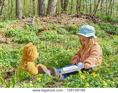 Cute Girl Reading Book Teddy Bear