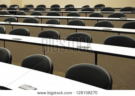 seats and long tables in college classroom
