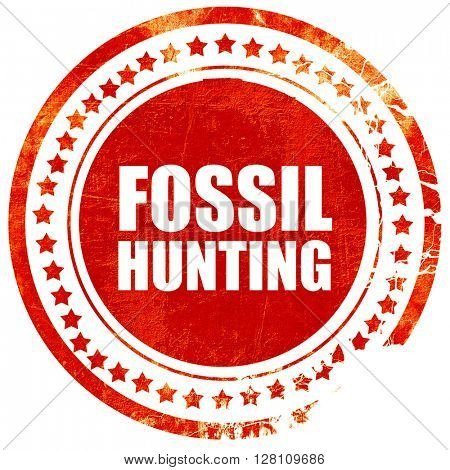 fossil hunting, red grunge stamp on solid background