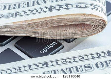 Close-up folded of US dollars banknotes on option sign Business concept.