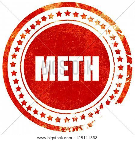 meth, red grunge stamp on solid background