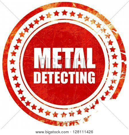 metal detecting, red grunge stamp on solid background