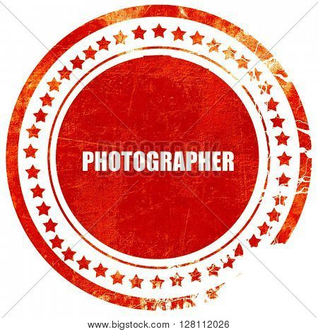 photographer, red grunge stamp on solid background