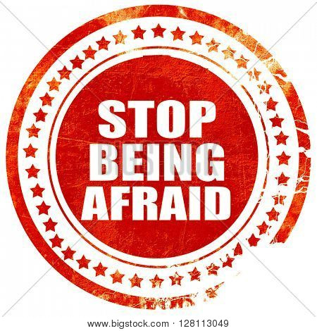 stop being afraid, red grunge stamp on solid background