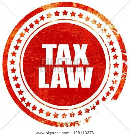 tax law, red grunge stamp on solid background