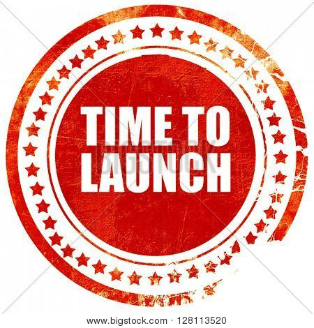 time to launch, red grunge stamp on solid background