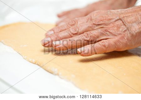 Strudel preparation : Stretching the strudels dough