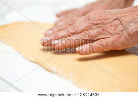 Strudel preparation : Stretching the strudels dough