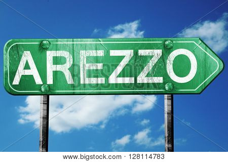 Arezzo road sign, 3D rendering, vintage green with clouds backgr