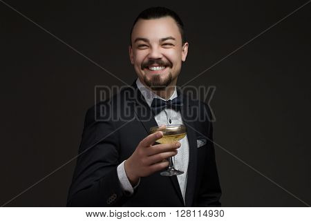 Attractive man with glass of champagne in his hand