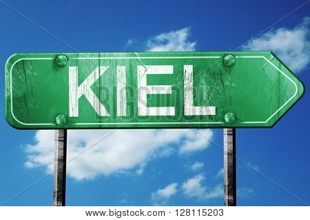 Kiel road sign, 3D rendering, vintage green with clouds backgrou